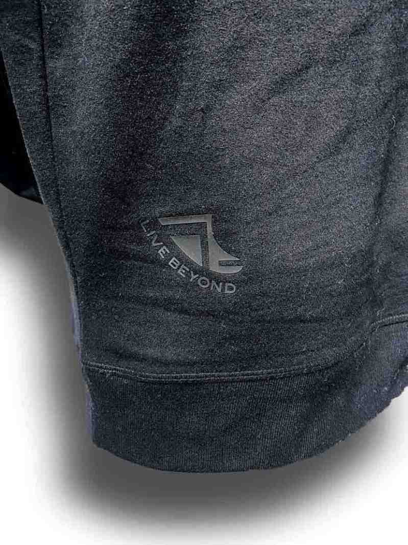 Close up image of Balance Collection Premium Black Hoodies Black rear silicone detail