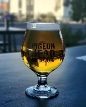 Goblet beer glass on bench outside