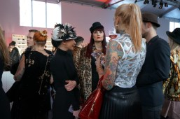 Tattoo Model Lexy Hell chats with other guests attending Lena Hoschek's 10th Anniversary Show