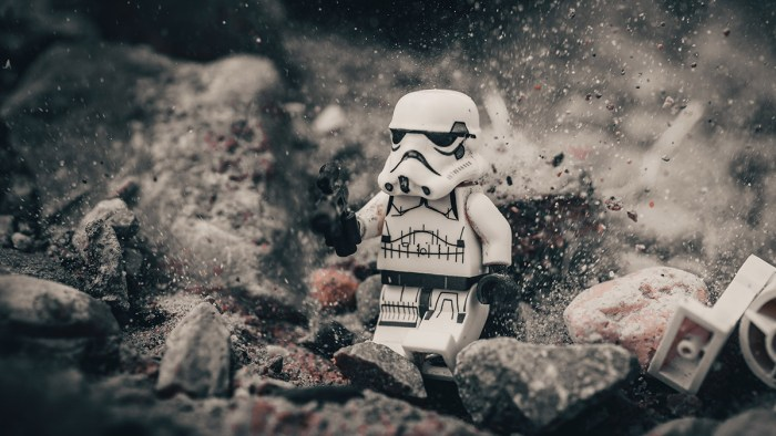 Lego Stormtropper running through rubble representing fatherhood challenges