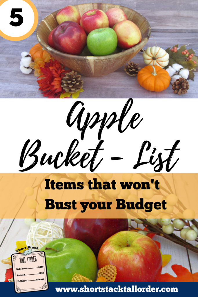 5 Apple Bucket List Items that won't bust your budget. Top picture-wooden bowl with green, red and yellow, and red apples in it. Acorns, leaves, cotton, and small pumpkins around bowl. Set behind a gray wood background.
