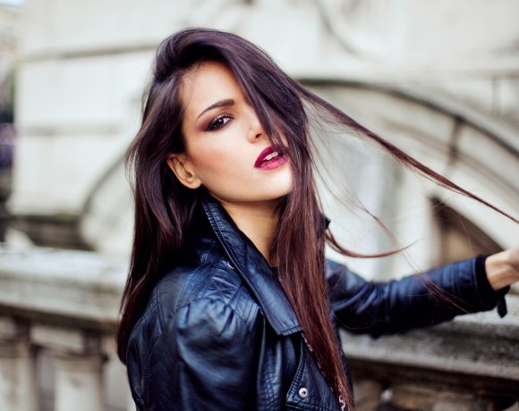 emotive portrait of a girl with dark hair in a black leather jacket