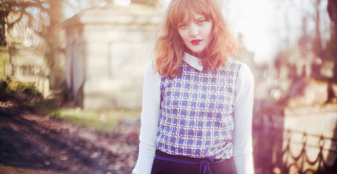 dreamy image of redhead fashion blogger Cosette Munch in a graveyard