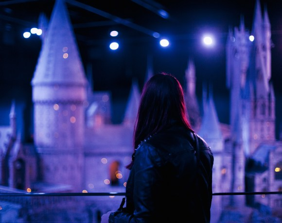 image of a girl in front of Harry Potter Hogwarts castle