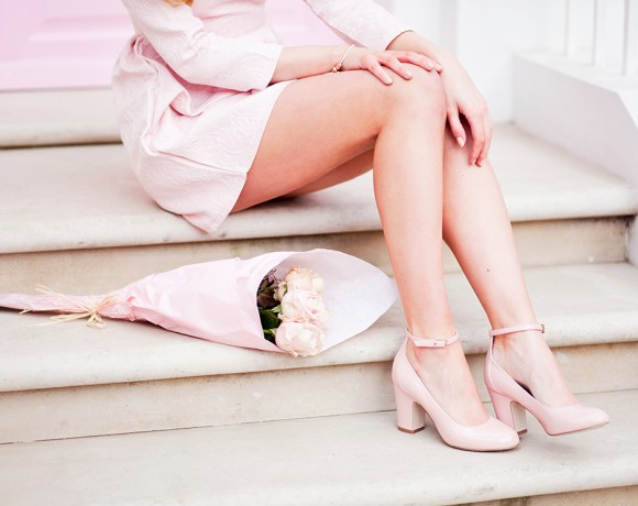close up of legs with pastel shoes and flowers