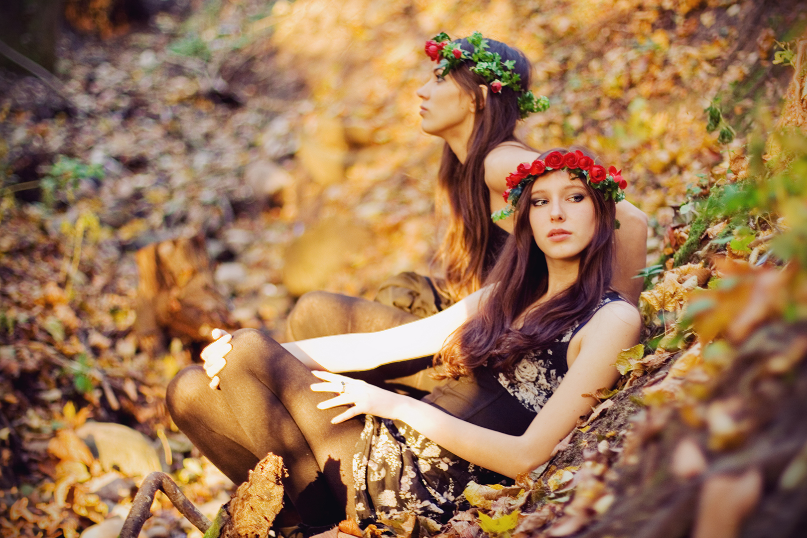 girls in flower crowns in a forest by Ailera Stone
