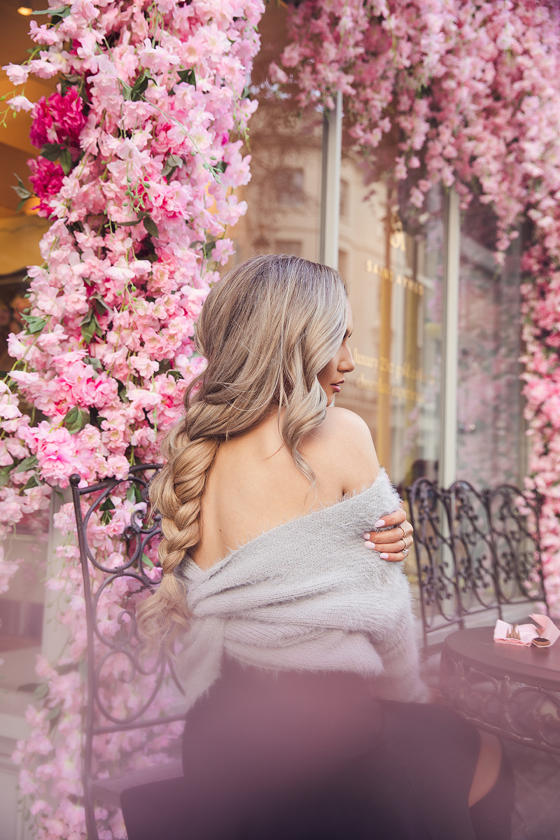 fashion blogger Stephanie Danielle photoshoot in front of floral Saint Aymes cafe by London fashion photographer Ailera Stone