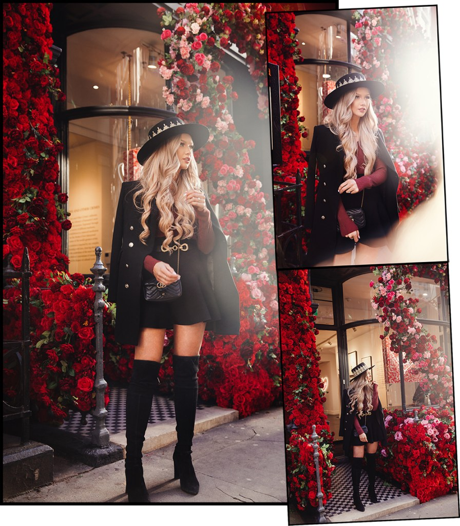 fashion blogger Stephanie Danielle in front red roses display at Maddox Gallery by London fashion photographer Ailera Stone