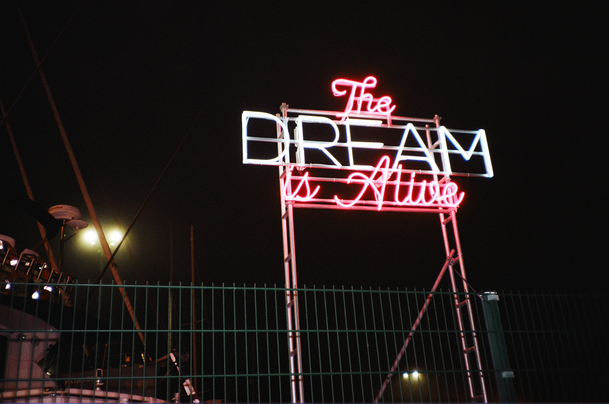 The Dream is alive neon sign on 35mm film diary in Nos Alive festival by London based photographer Ailera Stone