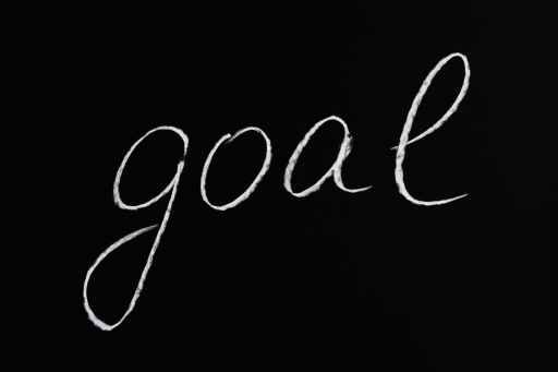goal lettering text on black background big life decisions