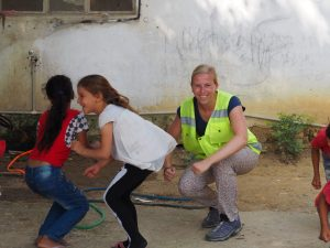 refugee kids warming up for gymnastics