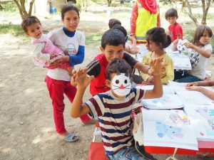 refugee children making masks