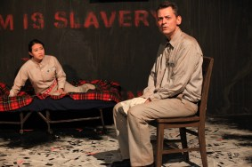 left to right) Sarah Lo and Ray Kasper in AstonRep Theatre Company's production of 1984. Photo by Emily Schwartz.