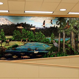 Right mosaic mural wall detail with wildlife,freshwater fish, Mt Rainier, pioneers, loggers, birdlife.