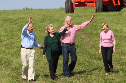Tom Harkin, Hillary Clinton, Bill Clinton, and Ruth Harkin in Indianola, Iowa [September 2014 file photo].