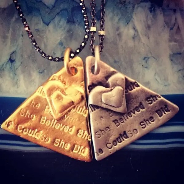 Higher Self necklaces in silver and gold stamped with the words