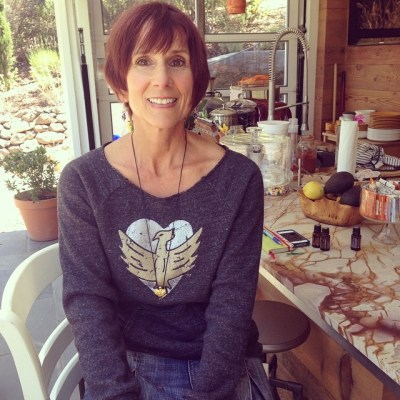 Super-chef Bernadette wears our gold 'Phoenix Heart' necklace and limited edition sweater designed by Jen! 100% of profits from Phoenix Heart sales go to cancer research. #showthelovejewelry #riseup #phoenix #heart #fightcancer