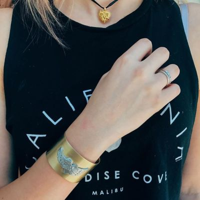 Decked out in @showthelovejewelry today at the office! Here we have pictured our Alis Volat cuff, two Celestial Bliss rings, and our beloved I Am Loved locket choker ️