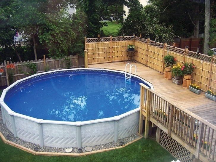 40 uniquely awesome above ground pools with decks for Above ground pool landscaping ideas australia