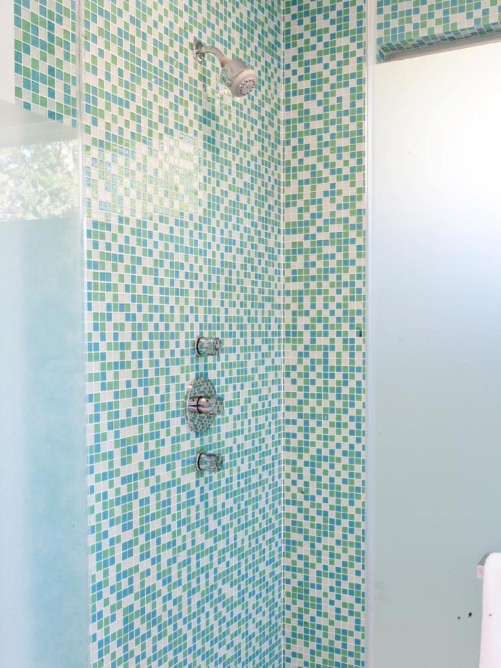 Mosaic tile on the walls with small white subway tiles