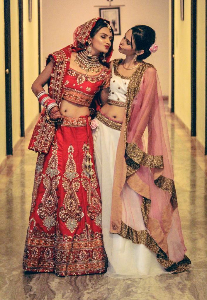 indian wedding bride and sister lehenga