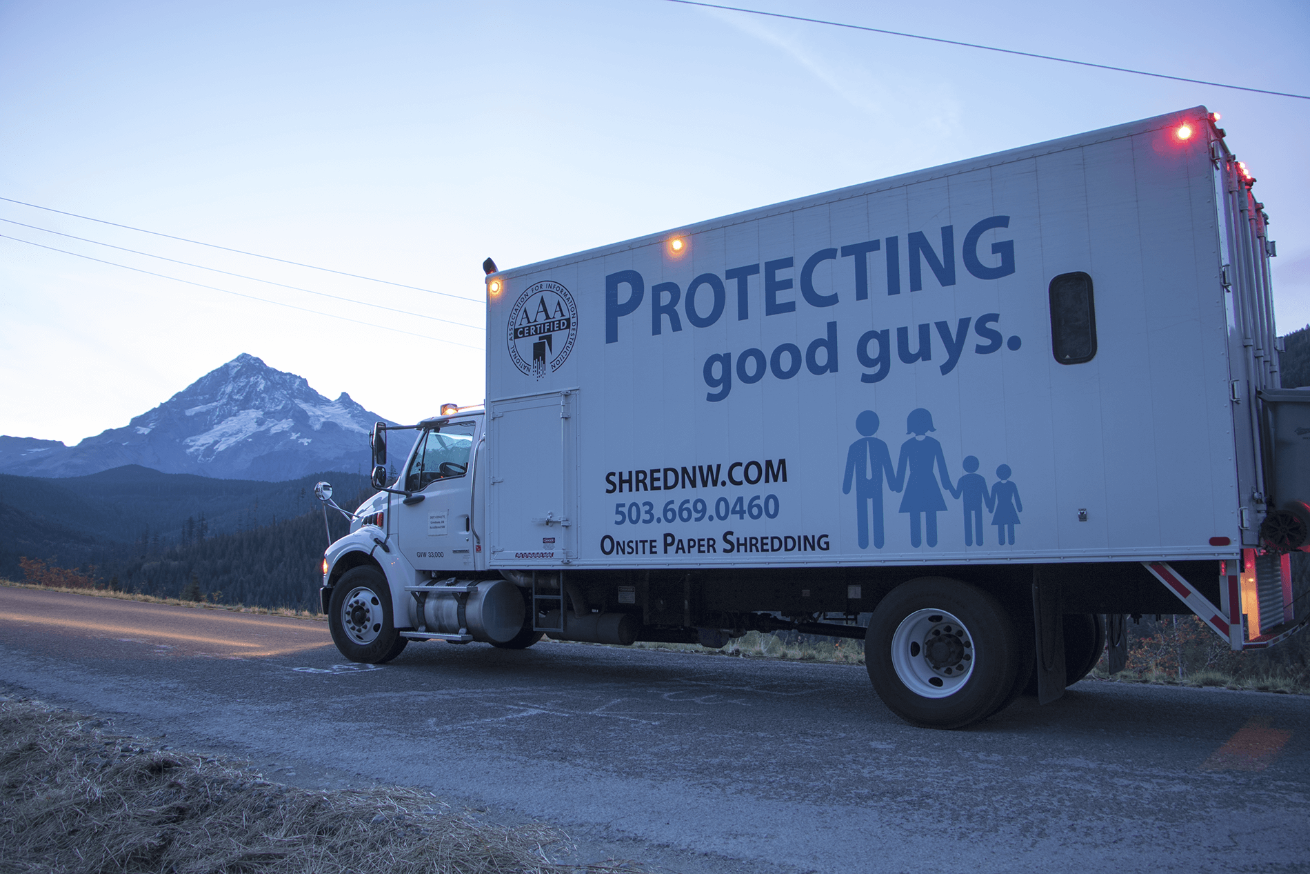 """Shred Racism: Mobile Shred Truck with artwork """"protecting good guys""""."""
