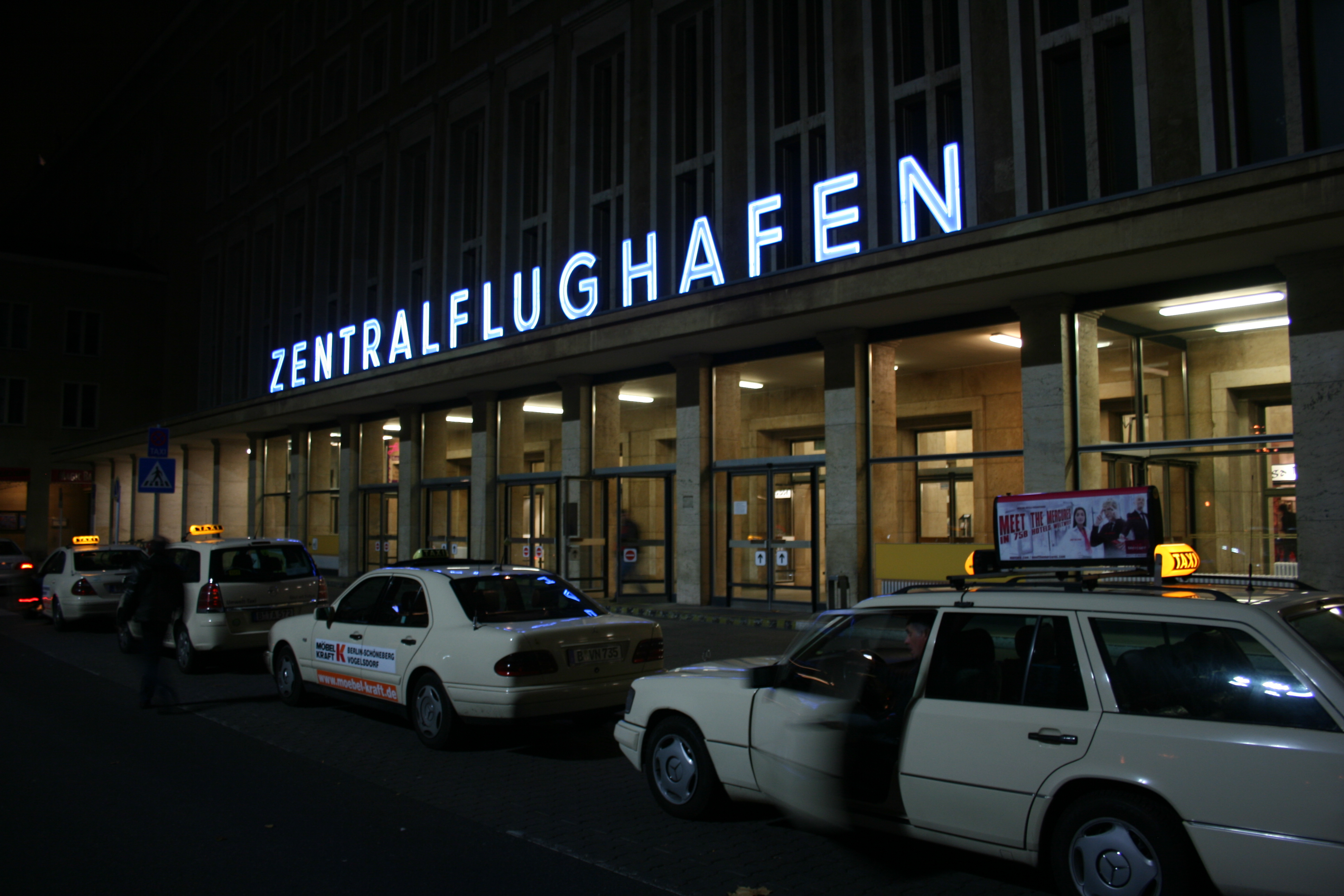 taxi stand and neon sign