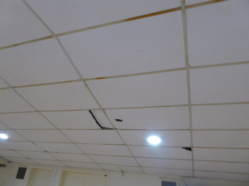village hall ceiling tiles before