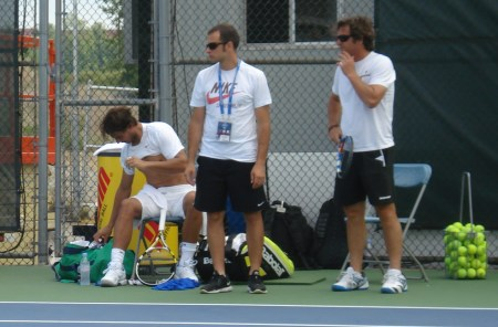 Rafael Nadal shirt change Cincinnati Western and Southern Open Sunday practice shirtless white shirt belly half on