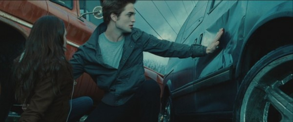 Twilight Edward Cullen Robert Pattinson stopping car protecting Bella hand truck screencaps images pictures photos screengrabs stills movie