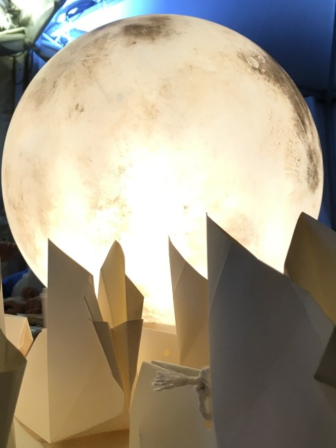 Glass moon and paper rabbits.