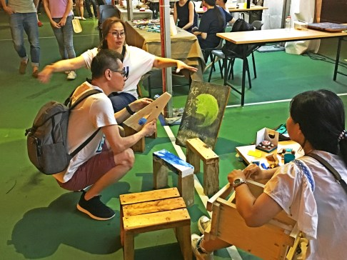 People making wooden chairs.