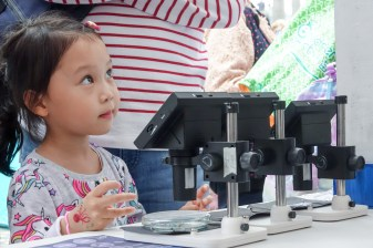 After inspecting the micro-plastics under the microscope, the child listens to the staff on what we could do to stop them from insidiously entering our ecosystem.