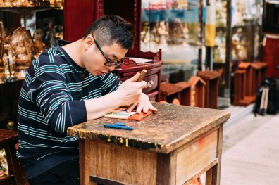 The 6th generation Kwok Kin-kwan is still an apprentice learning the skills from his father and uncle to pass on the wood carving handicraft techniques in Hong Kong.