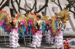 The dragon dancers setting out props to prepare for the performance beside the stage