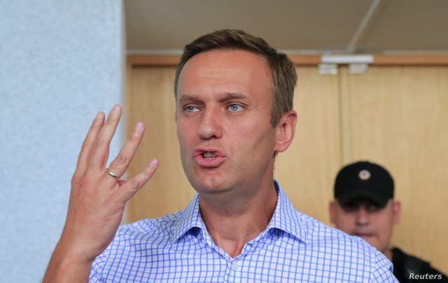 Russian opposition leader Alexei Navalny, who is charged with participation in an unauthorized protest rally, attends a court hearing in Moscow, Russia, July 1, 2019..