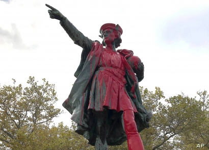 Red paint covers a statue of Christopher Columbus, Oct. 14, 2019, in Providence, R.I., after it was vandalized on the day named to honor him as one of the first Europeans to reach the New World.