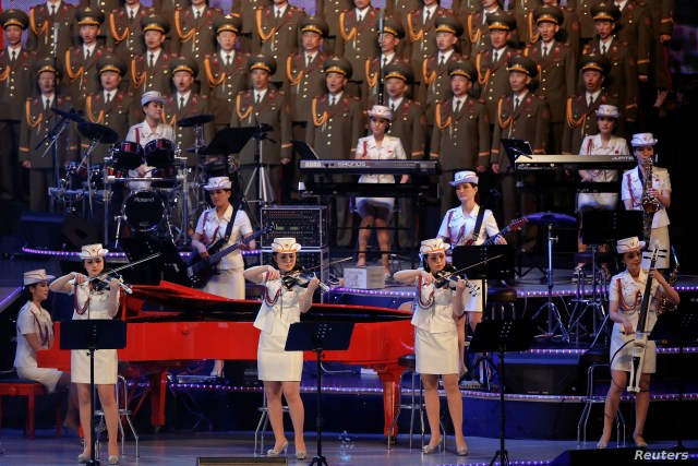 FILE - The Moranbong Band, an all-female North Korean pop band formed by leader Kim Jong Un, performs at a concert marking the end of the 7th Workers' Party Congress in Pyongyang, North Korea, May 11, 2016.