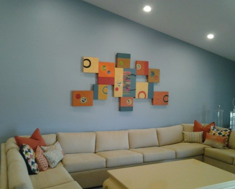 Lee's Assemblage series pieces display on the wall.