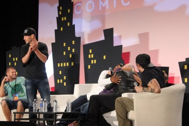"A fan asked for a hug from ""The Walking Dead""'s Jon Bernthal. In response, Michael Rooker drags her to the stage for a hug, which Lawrence Gilliard Jr. also joins in on. What a happy fan! Photo by Catherine Gutierrez"