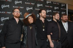 The Digital Wild pose with Black Fret co-founder Collin Kendrick. The band received a major grant.