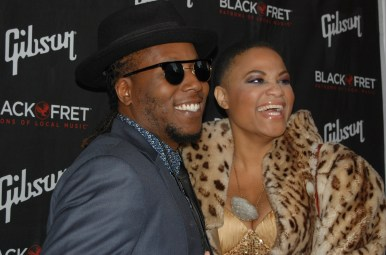Tameca Jones and a fellow band mate smile for cameras at the red carpet of Black Fret's Black Ball gala. Tameca received a major grant.