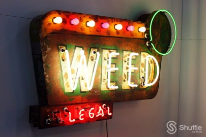 """Weed"" by artist Todd Sanders: Weed Sign. Styled after the old motel signs, the ""IL"" in ""ILLEGAL"" turns off and on in the manner of ""NO"" VACANCY. / Photo by Ray Gilford"