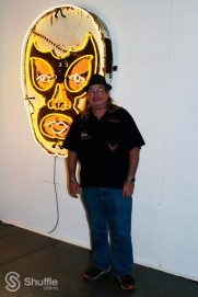 "Artist Todd Sanders in front of his ""White Luchador"" / Photo by Ray Gilford"