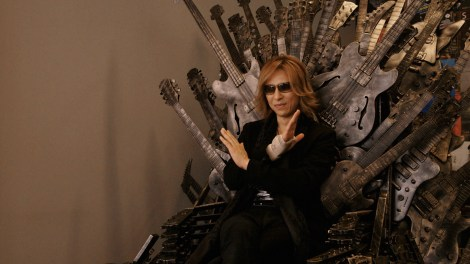 """Yoshiki sits triumphantly atop a guitarthemed version of the Iron Throne in Drafthouse Films' """"We Are X."""" / Courtesy of Drafthouse Films"""