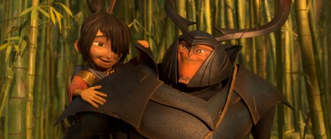 2700.0040.still.laika.00014 (l-r.) Kubo (voiced by Art Parkinson) gets a lift from his new friend and ally Beetle (Academy Award winner Matthew McConaughey) in animation studio LAIKA's epic action-adventure KUBO AND THE TWO STRINGS, a Focus Features release. Credit: Laika Studios/Focus Features