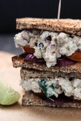 This easy, healthy chickpea salad between two slices of whole grain bread has chickpeas, almonds, and cranberries.