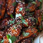 Air Fryer Chicken Wings with chopped cilantro and sesame seeds