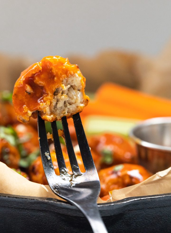 closeup of the meatball on a fork.