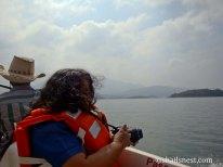 Moi in an orange life jacket while boating at Banasura dam